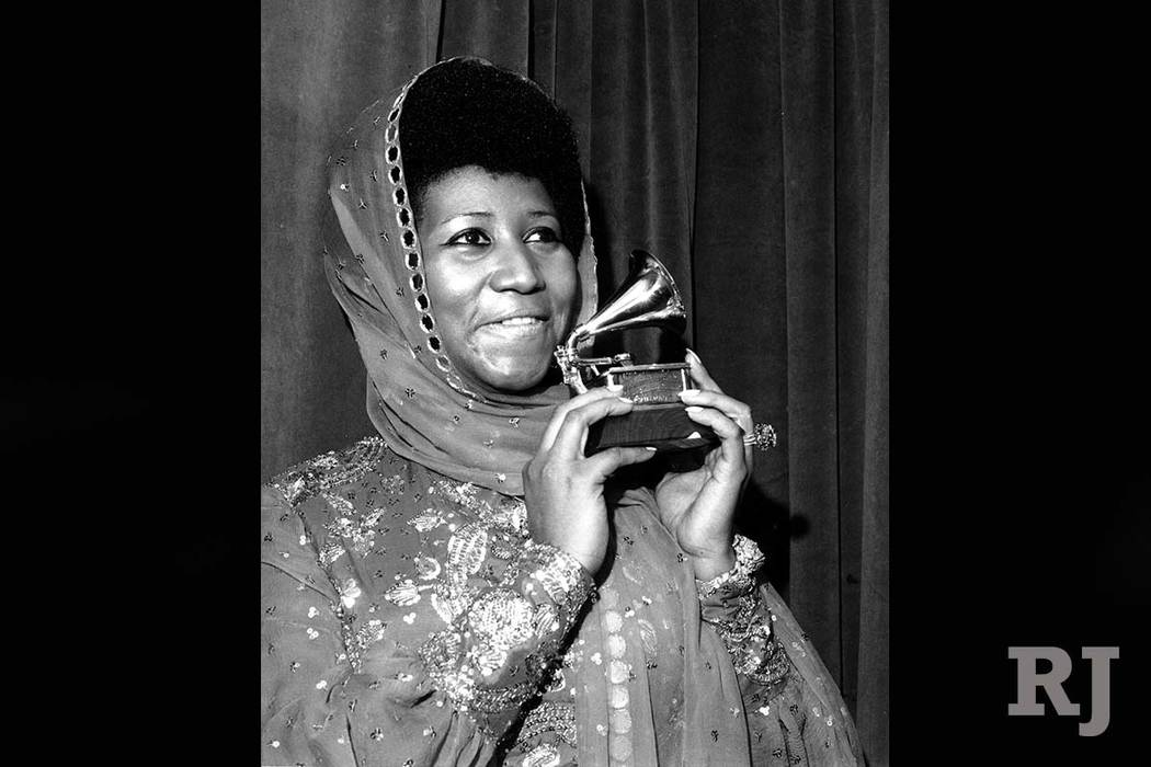 "Aretha Franklin poses with her Grammy Award at the 17th Annual Grammy Award presentation in New York in 1975. The award was for her performance in ""Ain't Nothing Like the Real Thing."" (AP Photo)"