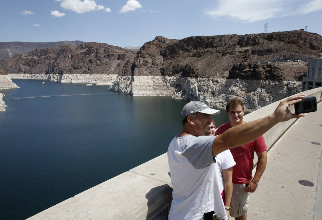 Tourists take a selfie while visiting the Hoover Dam on Thursday, Aug. 16, 2018, in Las Vegas. Bizuayehu Tesfaye/Las Vegas Review-Journal @bizutesfaye
