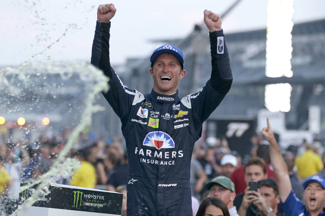 In this July 23, 2017, file photo, Kasey Kahne (5) celebrates winning the NASCAR Brickyard 400 auto race at Indianapolis Motor Speedway in Indianapolis. (AP Photo/Michael Conroy, File)