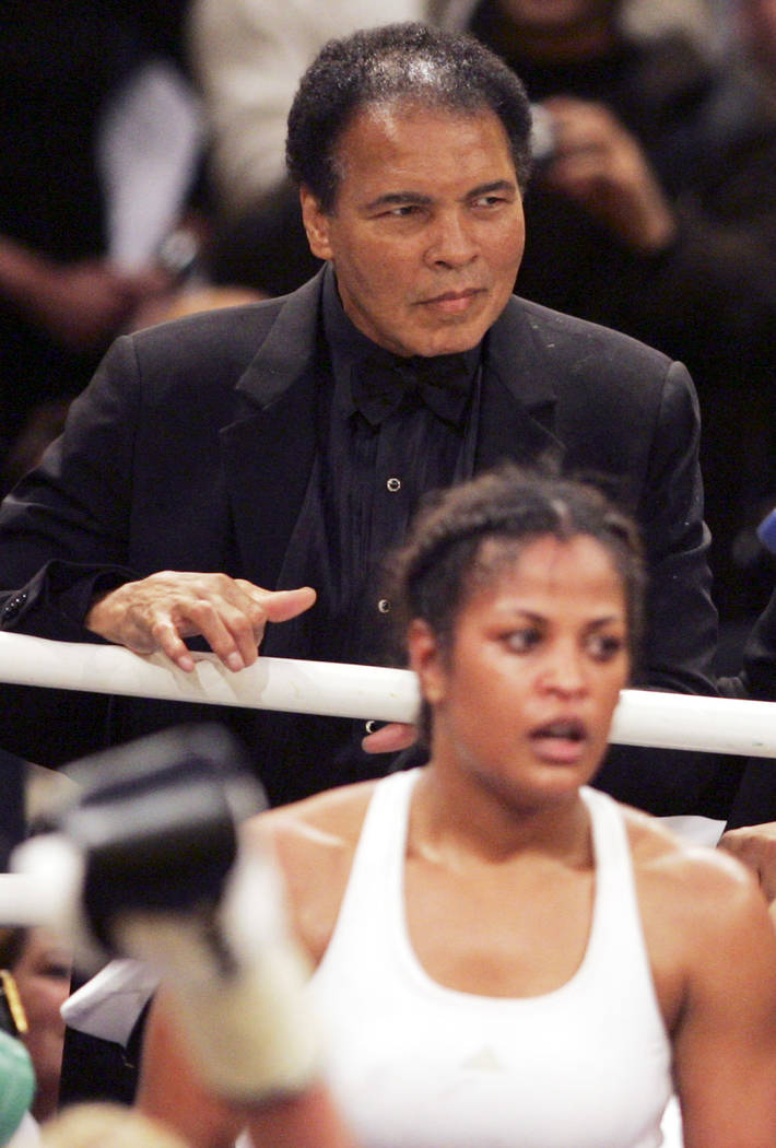 Muhammad Ali, left, looks to his daughter Laila after she won the no-title fight against Asa Maria Sandell from Sweden, in Berlin on Saturday, Dec. 17, 2005. (AP Photo/Markus Schreiber)