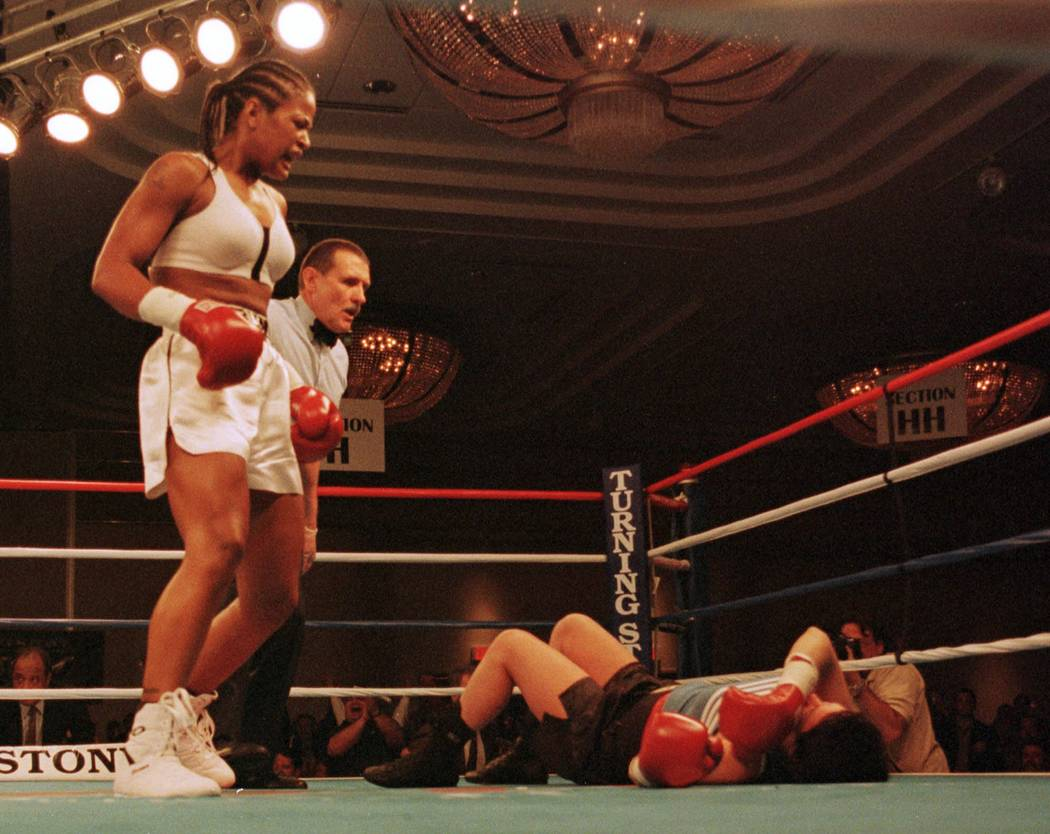 Laila Ali, left, stands over April Fowler after she knocked down Fowler at 31 seconds of the first round of their middleweight fight Friday, Oct. 8, 1999, at the Turning Stone Casino Resort in Ver ...