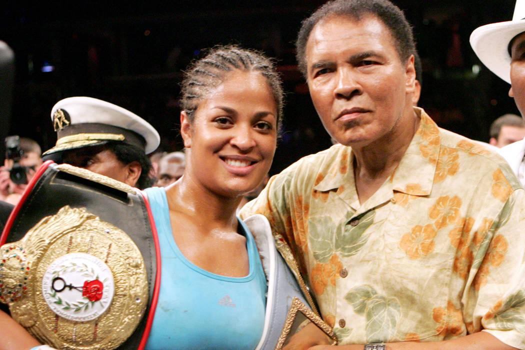 Laila Ali, left, poses with her father, boxing great Muhammad Ali, after her win against Erin Toughill, Saturday, June 11, 2005,at the MCI Center in Washington. (AP Photo/Pablo Martinez Monsivais)