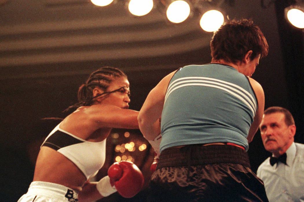 Laila Ali, left, lands a right to April Fowler in the first round of their middleweight fight Friday, Oct. 8, 1999, at the Turning Stone Casino Resort in Verona, N.Y. Ali knocked out April Fowl ...