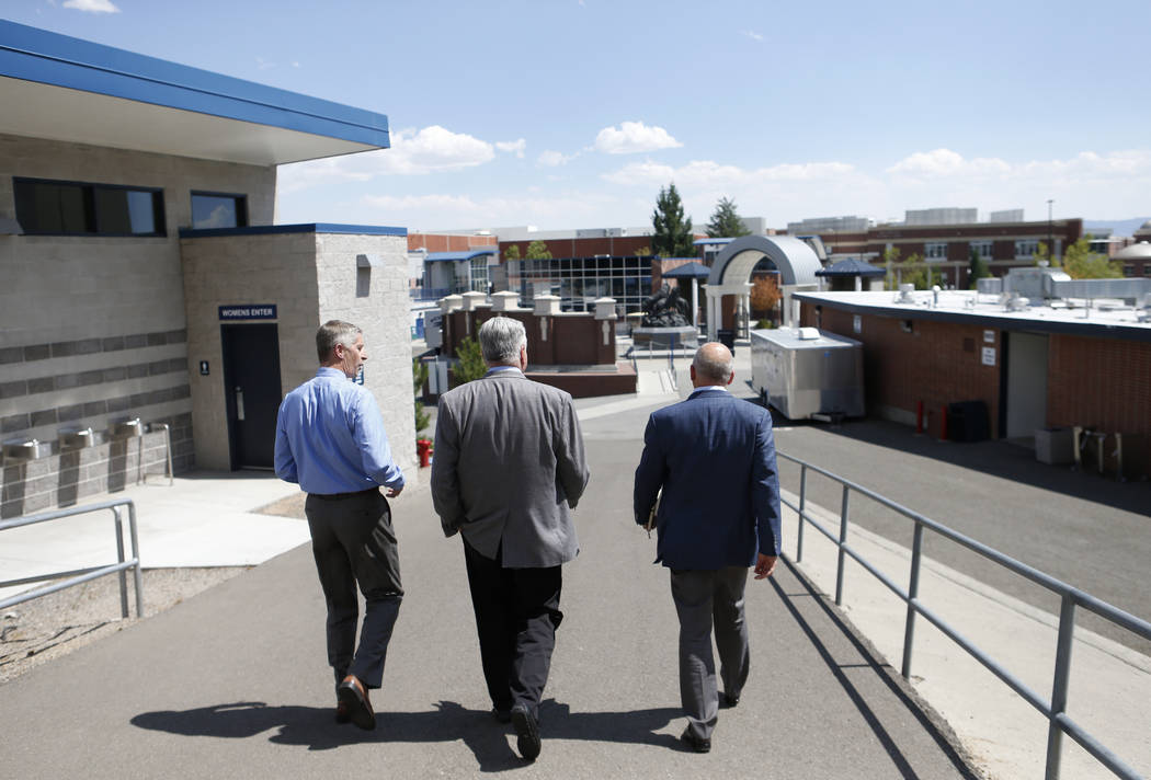 University of Nevada, Reno Athletic Director Doug Knuth, left, takes Democratic governor candidate Steve Sisolak, center, and Raiders president Marc Badain on a tour of their athletic facilities i ...