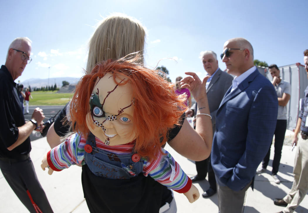 Wooster High School Principal Leah Keuscher wears her Raiders and a Chucky doll to welcome Raiders president Marc Badain on a tour of the campus on Thursday, Aug. 16, 2018. The Raiders are conside ...