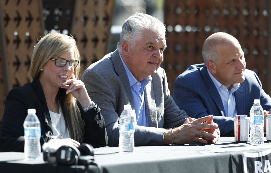 From left, Reno Mayor Hillary Schieve, Democratic governor candidate Steve Sisolak and Raiders president Marc Badain, hold a press conference in Reno, Nev., on Thursday, Aug. 16, 2018. The Raiders ...