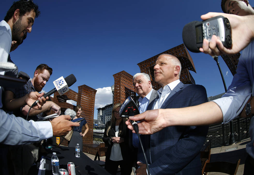 Reno Mayor Hillary Schieve, Democratic governor candidate Steve Sisolak and Raiders president Marc Badain, answer questions following a press conference in Reno, Nev., on Thursday, Aug. 16, 2018. ...