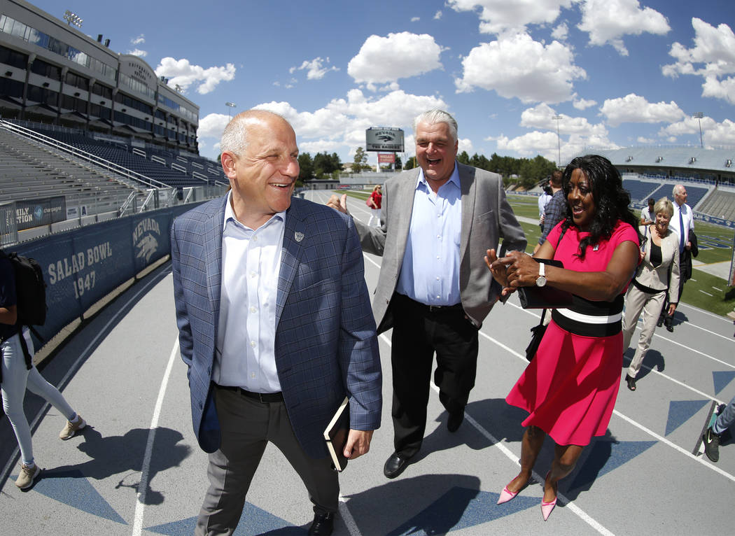 Raiders president Marc Badain, left, Democratic governor candidate Steve Sisolak and Washoe County School Board Trustee Dr. Angie Taylor talk during a tour of the University of Nevada, Reno athlet ...