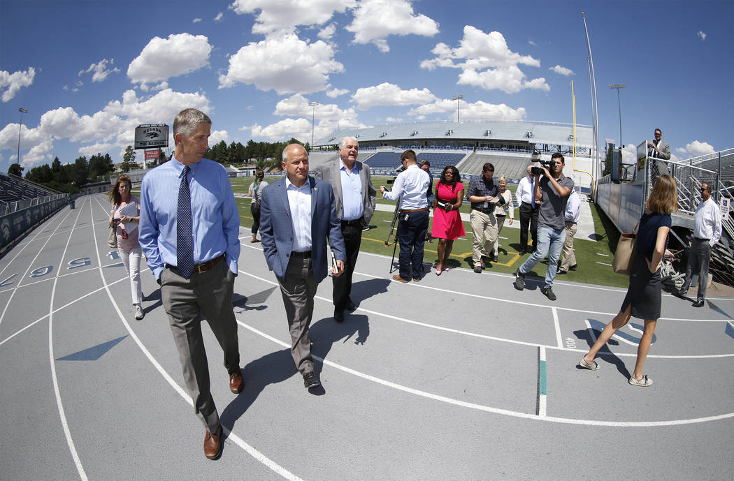 University of Nevada, Reno Athletic Director Doug Knuth, left, takes Raiders president Marc Badain and Democratic governor candidate Steve Sisolak on a tour of their athletic facilities in Reno, N ...