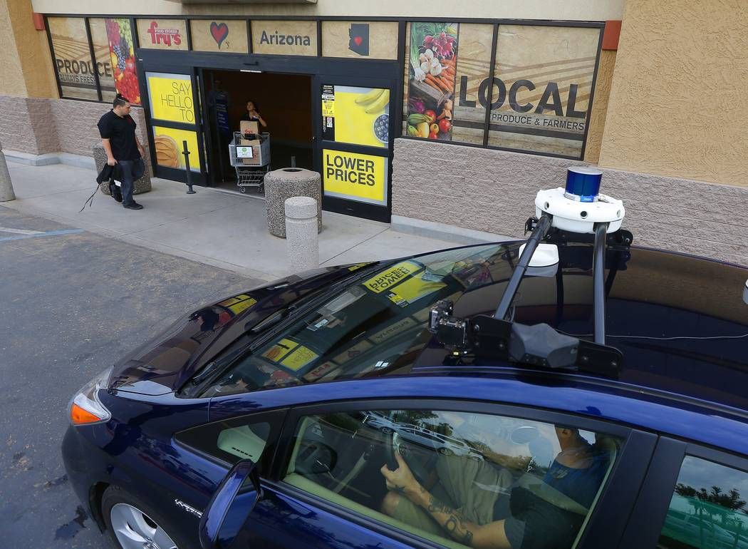 A self-driving Nuro vehicle parks outside a Fry's supermarket, which is owned by Kroger, as part of a pilot program for grocery deliveries Thursday, Aug. 16, 2018, in Scottsdale, Ariz. (AP Photo/R ...