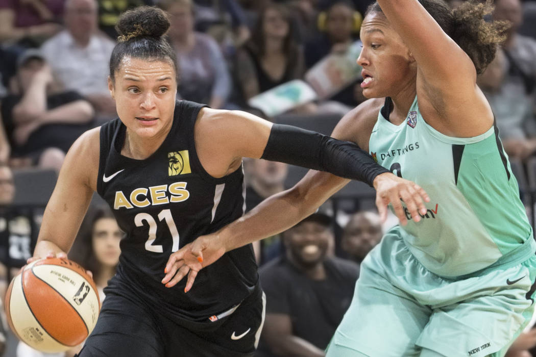 Aces guard Kayla McBride (21) drives baseline past New York Liberty guard Marissa Coleman (0) in the fourth quarter on Wednesday, Aug. 15, 2018, at the Mandalay Bay Events Center, in Las Vegas. Be ...
