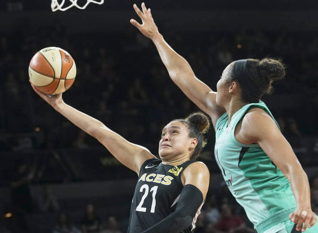 Aces guard Kayla McBride (21) drives past New York Liberty guard Kiah Stokes (41) in the fourth quarter on Wednesday, Aug. 15, 2018, at the Mandalay Bay Events Center, in Las Vegas. Benjamin Hager ...