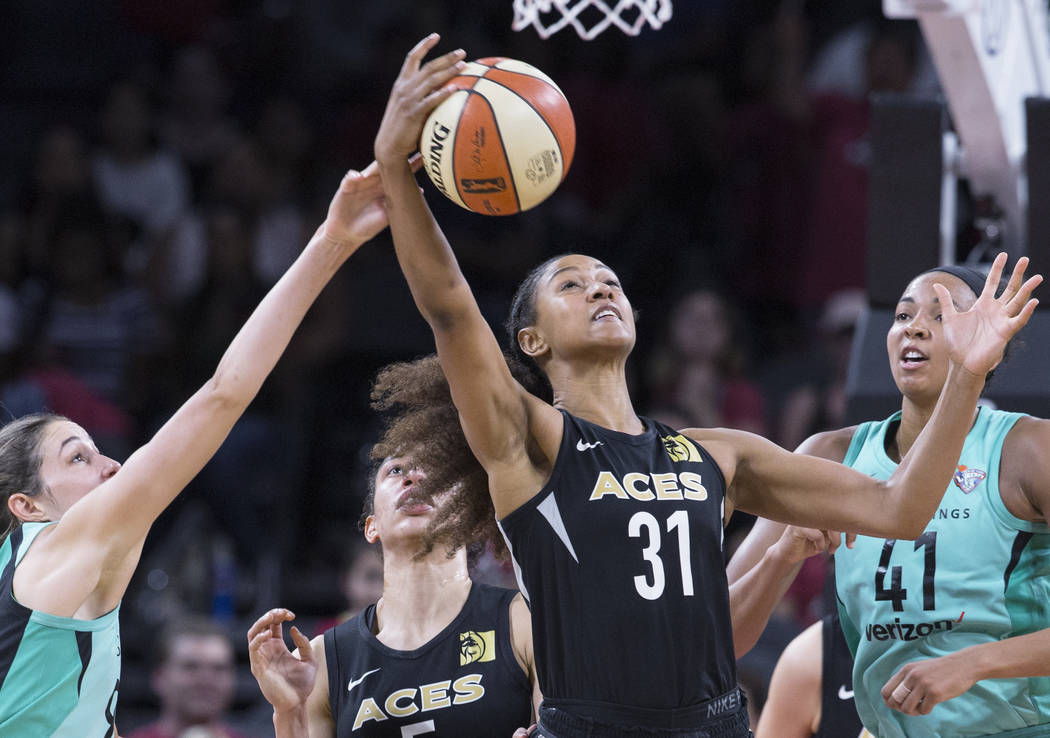 Aces guard Jaime Nared (31) fights for a loose ball with New York Liberty defenders Kiah Stokes (41) and Rebecca Allen (9) in the fourth quarter on Wednesday, Aug. 15, 2018, at the Mandalay Bay Ev ...