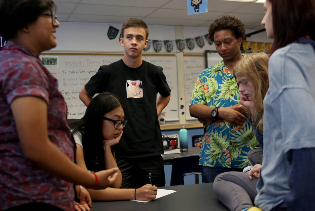 Michelle Garcia, 16, from left, Angely Salazar, 16, Raphael Moll, 16, Jayden Davis, 17, Dash Chrisman, 17, and Emma-Nikole Georgiev, 17, brainstorm ideas for videos to inform people about the robo ...