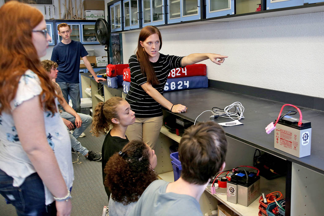 Dawn Trujillo talks to her robotics class at Las Vegas Academy in Las Vegas, Thursday, Aug. 16, 2018. The robotics team—the Robot Pigeons—was created last year and won second place i ...