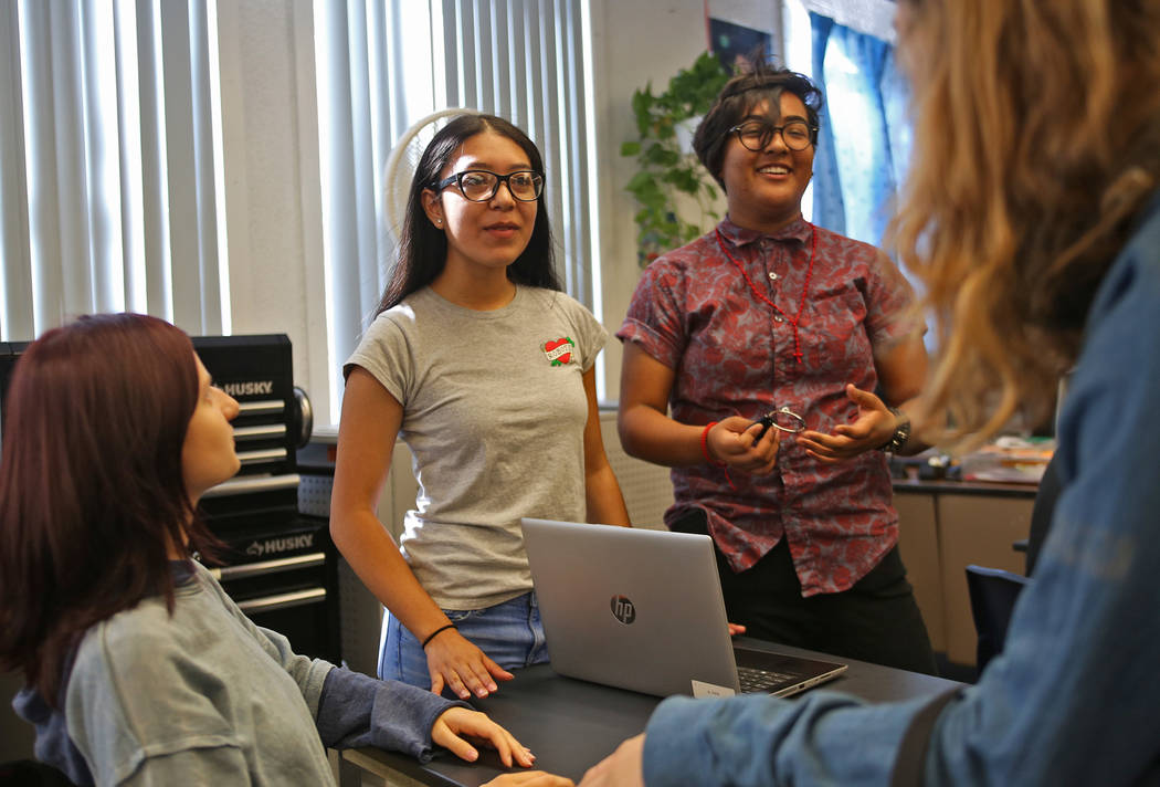 Emma-Nikole Georgiev, 17, from left, Angely Salazar, 16, and Michelle Garcia, 16, brainstorm ideas for videos to inform people about the robotics team in order to raise money at Las Vegas Academy ...