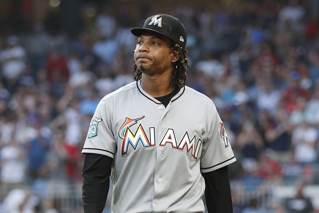 Miami Marlins starting pitcher Jose Urena leaves the field after being ejected for hitting Atlanta Braves' Ronald Acuna Jr. with a pitch during the first inning of a baseball game Wednesday, Aug. ...