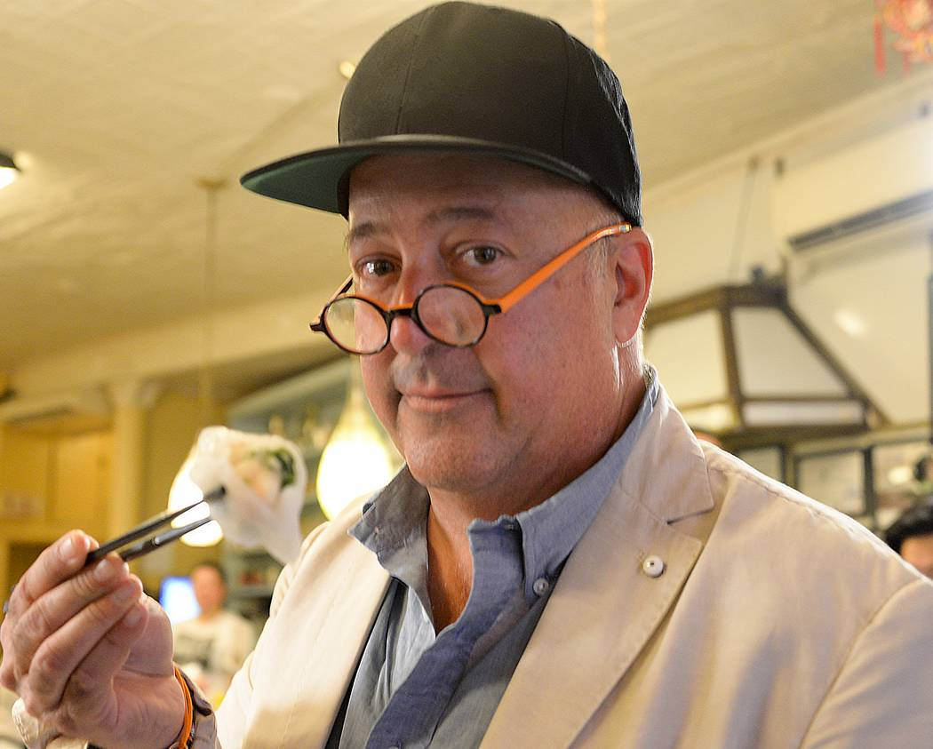 Host Andrew Zimmern shows off his new cap and chopsticks skills at Nom Wah Tea Parlor. As seen on Travel Channel's The Zimmern List.