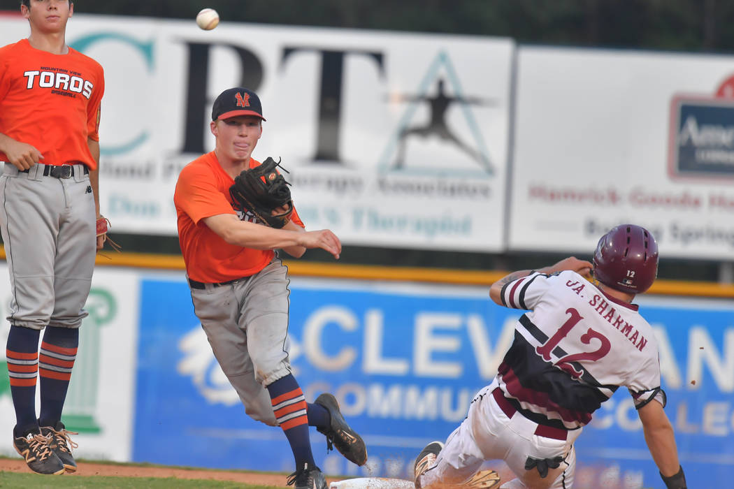 Carson Smith of Meridian, Idaho, forces out Jason Sharman of the Desert Oasis Aces during the American Legion World Series at Veterans Field at Keeter Stadium in Shelby, N.C., on Thursday, Aug. ...