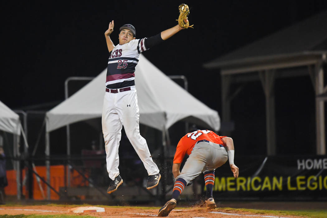 Matthew Reynolds of Meridian, Idaho, ducks under Aaron Roberts of the Desert Oasis Aces at first in the top of the fourth inning during the American Legion World Series at Keeter Stadium in Shel ...