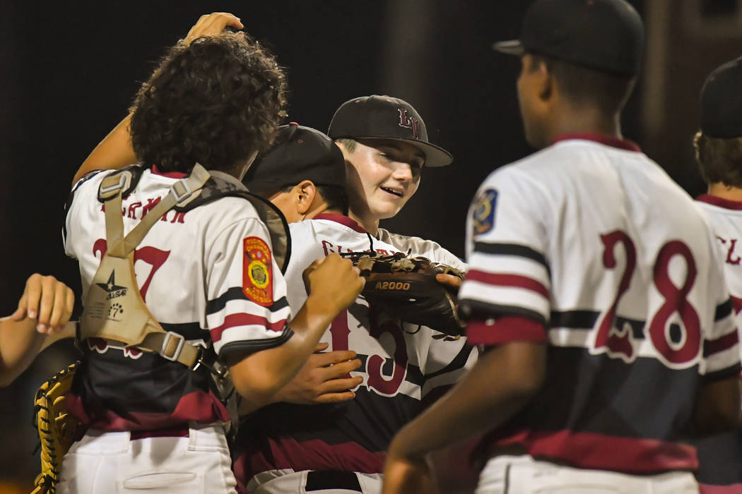 The Desert Oasis Aces celebrate after their 10-0 victory in five innings over Meridian, Idaho, at Veterans Field at Keeter Stadium in Shelby, N.C., on Thursday, Aug. 16, 2018. Lucas Carter/The Ame ...