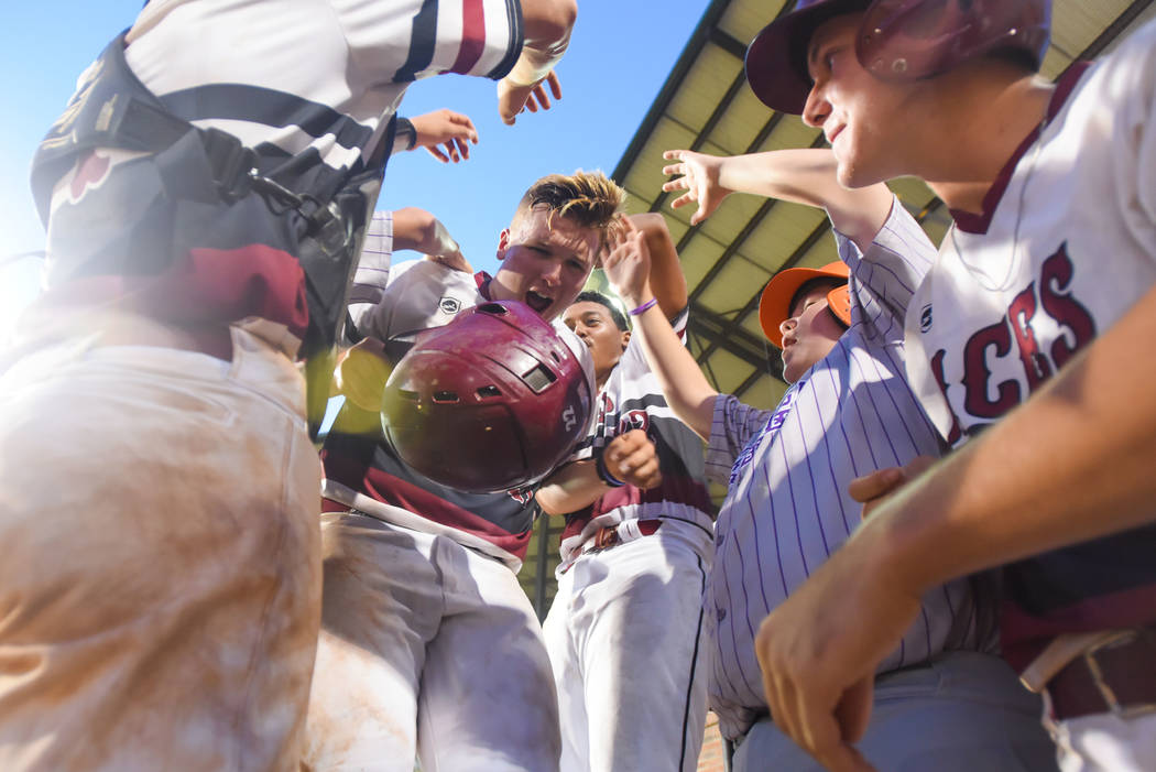 Chaison Miklich is swarmed by his Desert Oasis Aces teammates after scoring a run during the American Legion World Series at Keeter Stadium in Shelby, N.C., on Thursday, Aug. 16, 2018. Lucas Cart ...