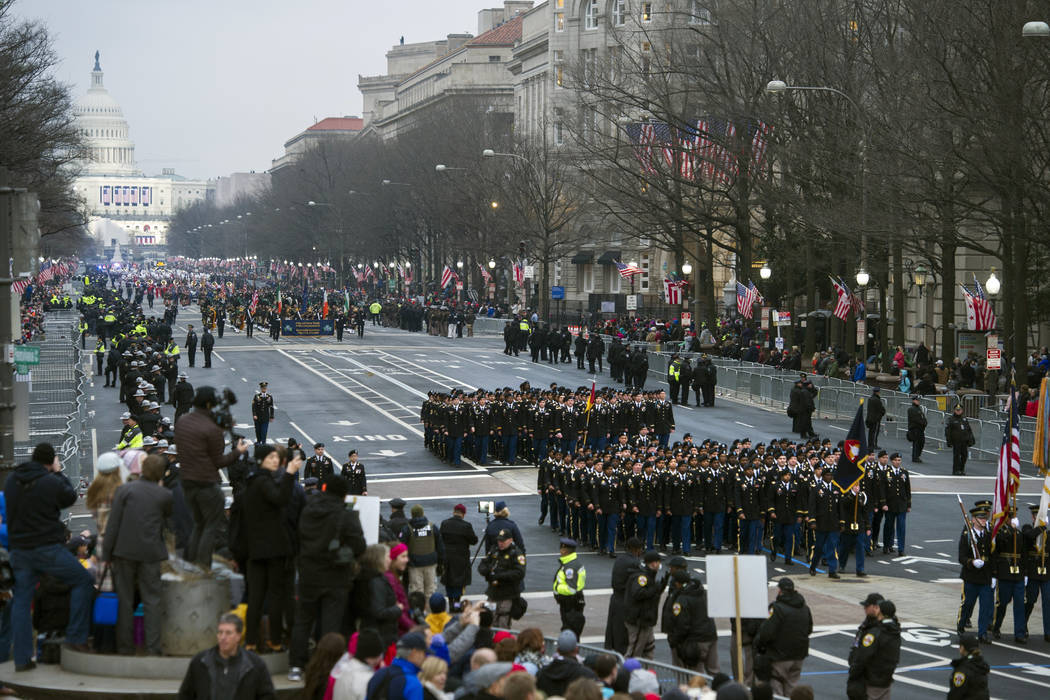 In this Jan. 20, 2017, file photo, military units participate in the inaugural parade from the Capitol to the White House in Washington, Friday, Jan. 20, 2017. A U.S. official says the 2018 Vetera ...