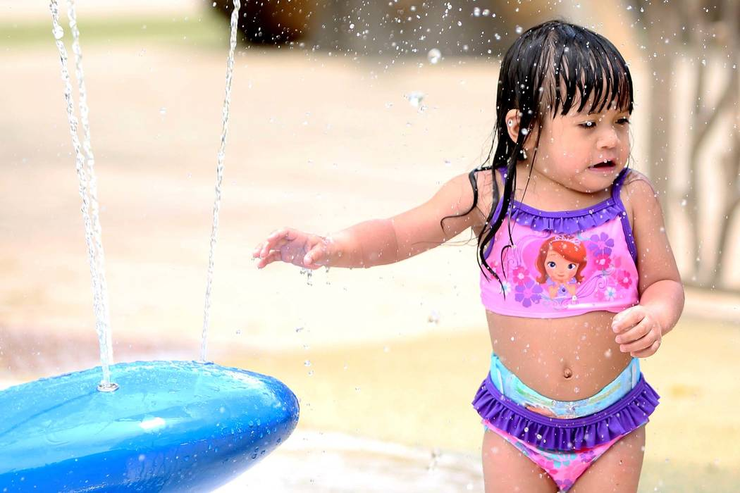 Faith Mena-Gutlay, 2, cools herself as she plays at Sunset Park. Temperatures will climb back to 108 over the weekend in the Las Vegas Valley. (Bizuayehu Tesfaye/Las Vegas Review-Journal) Follow @ ...