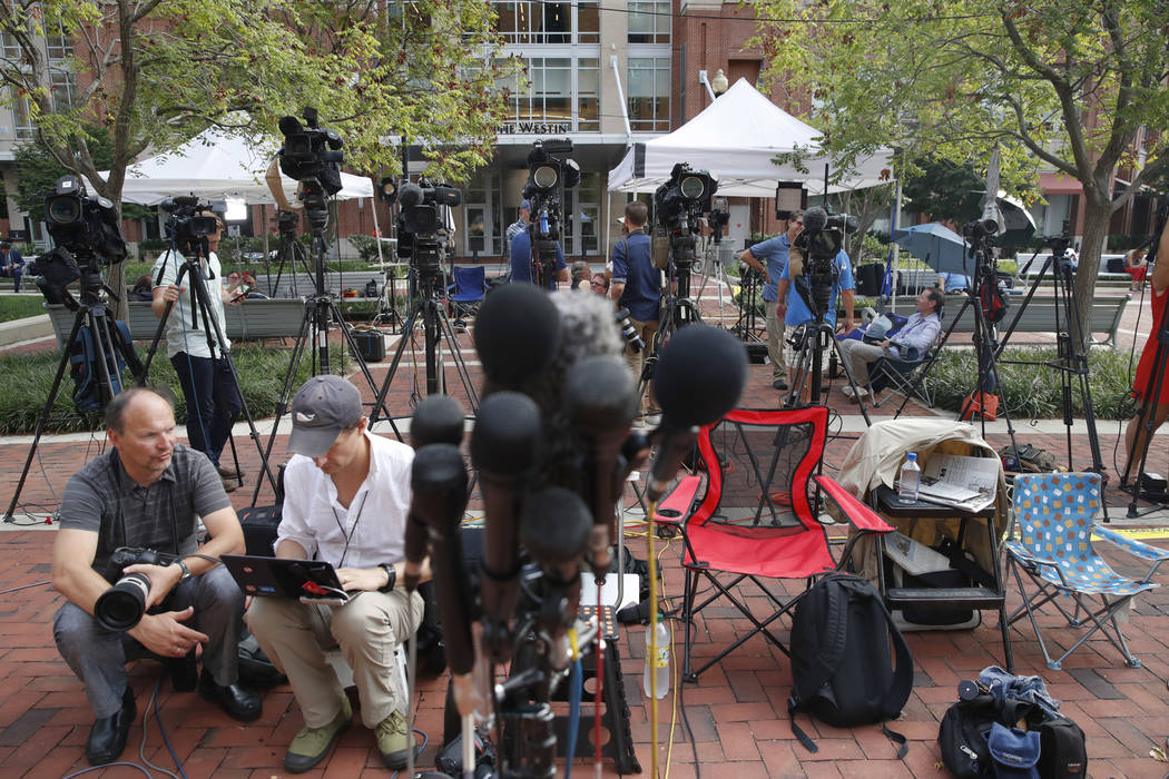 Members of the media as set up outside of federal court as jury deliberations are set to begin in the trial of former Trump campaign chairman Paul Manafort, in Alexandria, Va., Thursday, Aug. 16, ...