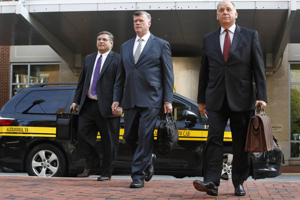 Defense attorneys Richard Westling, left, Kevin Downing, and Thomas Zehnle, walk to federal court as jury deliberations begin in the trial of former Trump campaign chairman Paul Manafort, in Alexa ...