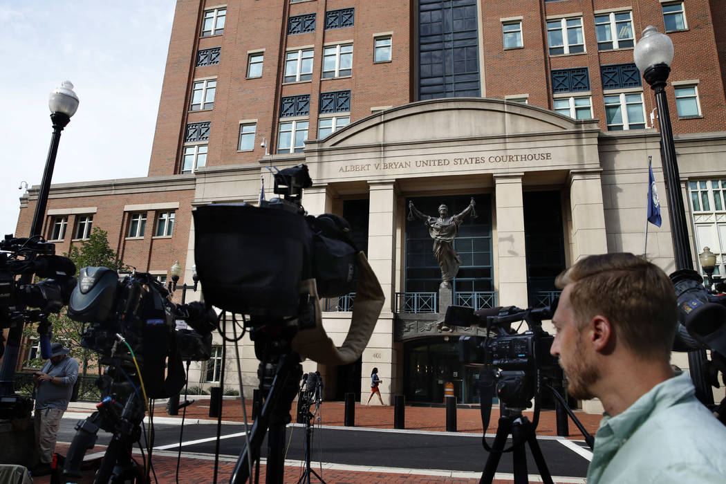 Television cameras are set up outside of federal court as jury deliberations are set to begin in the trial of former Trump campaign chairman Paul Manafort, in Alexandria, Va., Thursday, Aug. 16, 2 ...