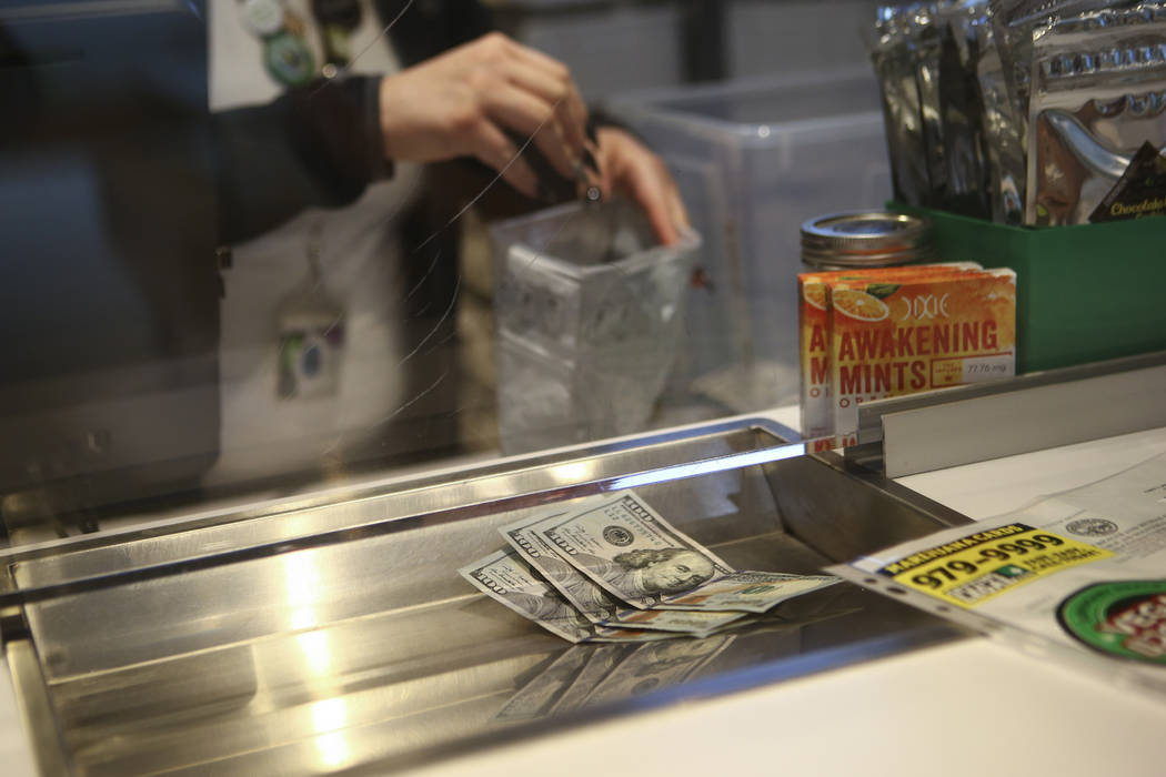 Money for products at medical marijuana dispensary The Source in Las Vegas on Thursday, March 30, 2017. (Chase Stevens/Las Vegas Review-Journal) @csstevensphoto