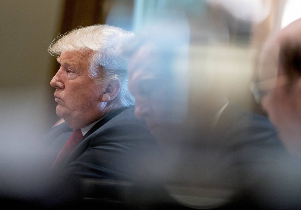 President Donald Trump listens as he attends a cabinet meeting in the Cabinet Room of the White House, Thursday, Aug. 16, 2018, in Washington. (Andrew Harnik/AP)