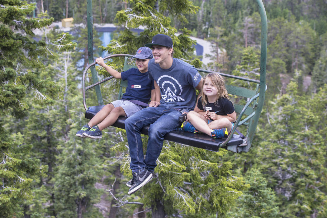 Quinn Bunevith, left, summer attendant Spencer Miller and Rory Kirk ride the Sherwood ski lift during Youth Adventure Day at Lee Canyon on Friday, July 20, 2018, in Las Vegas. Benjamin Hager Las V ...