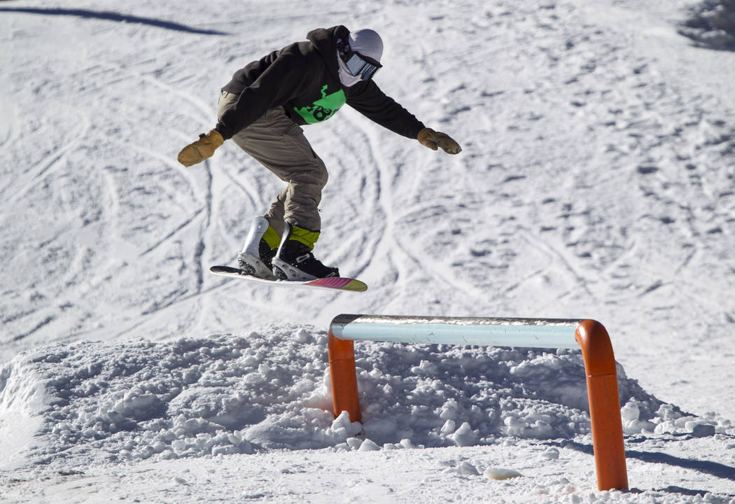 A snowboarder jumps on to a rail on the bunny hill on Friday afternoon, Dec. 8, 2017, at Lee Canyon opening day. Richard Brian Las Vegas Review-Journal @vegasphotograph