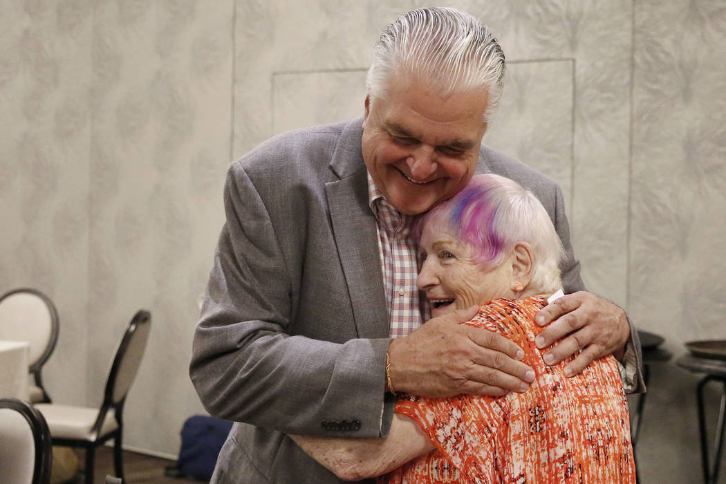 Democratic gubernatorial candidate, Steve Sisolak, greets Lorraine Pesso of Henderson during the Women's Chamber 2018 candidate forum luncheon event on Friday, Aug. 17, 2018, in Las Vegas. Bizuaye ...
