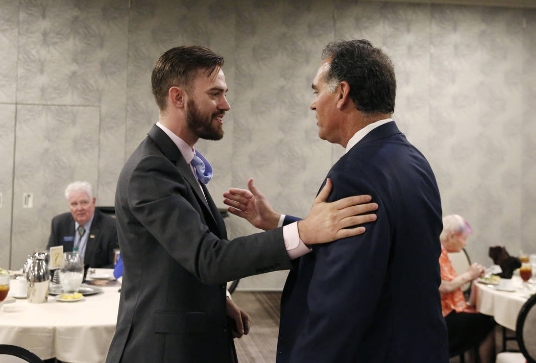 Paris Wade, left, Republican candidate for State Assembly, and Danny Tarkanian, Republican candidate for the 3rd Congressional District, greet each other during the Women's Chamber 2018 candidate ...