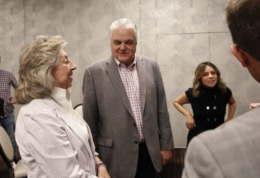 Dina Titus, Democratic candidate for the 1st Congressional District, left, and Democratic gubernatorial candidate Steve Sisolak chat during the Women's Chamber 2018 candidate forum luncheon event ...