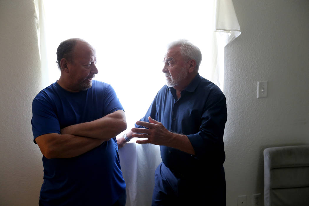 Francisco Pacheco, right, visits the room Thursday, Aug. 9, 2018, where his niece, Ethel Matteos, was found dead from an apparent suicide. John Beard, left, is a fellow resident of the independent ...