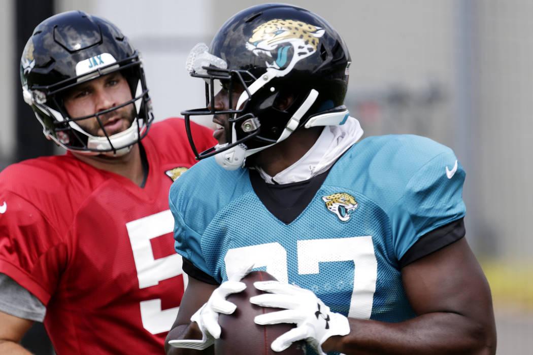 Jacksonville Jaguars running back Leonard Fournette runs away from quarterback Blake Bortles, who playfully chased Fournette down the field, during NFL football practice in Eagan, Minn., Wednesday ...