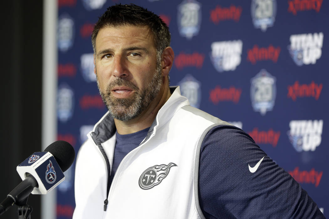 In this July 27, 2018, file photo, Tennessee Titans head coach Mike Vrabel answers questions during a news conference after a practice at NFL football training camp in Nashville, Tenn.(AP Photo/Ma ...