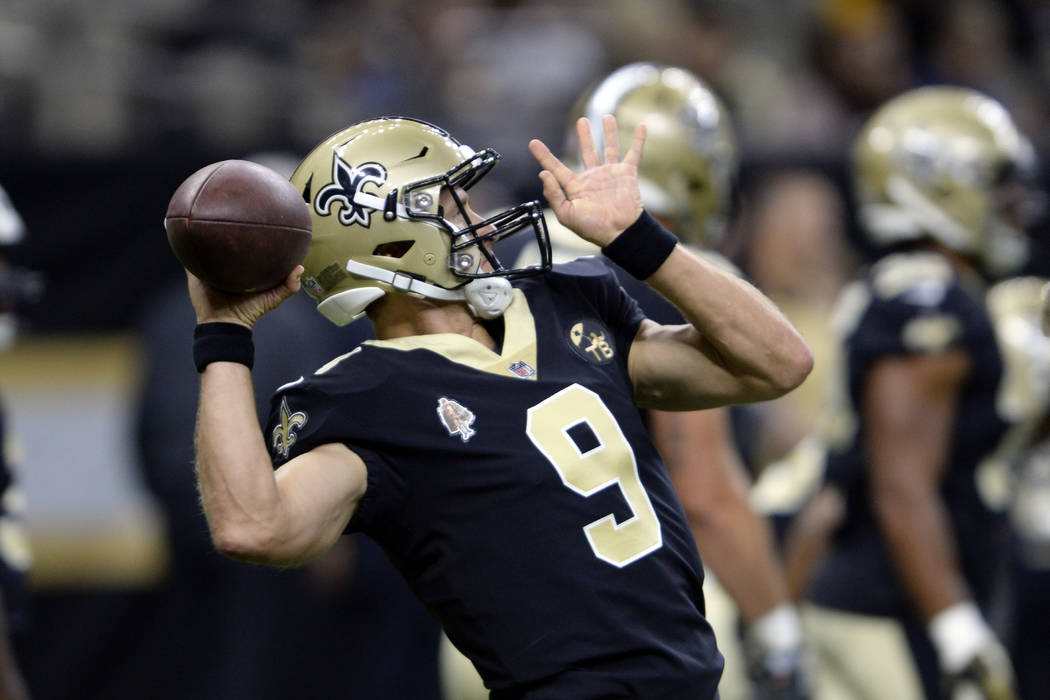 New Orleans Saints quarterback Drew Brees (9) warms up before an NFL preseason football game against the Arizona Cardinals in New Orleans, Friday, Aug. 17, 2018. (AP Photo/Bill Feig)