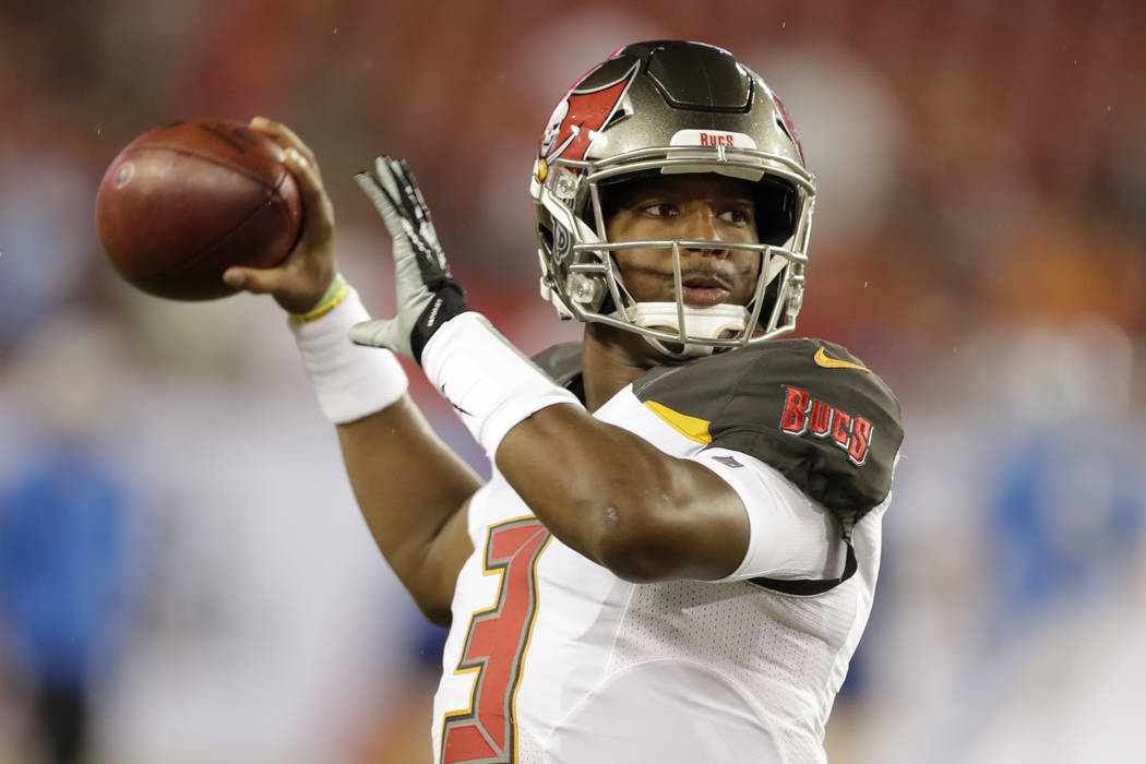 Tampa Bay Buccaneers quarterback Jameis Winston throws a pass before an NFL preseason football game against the Detroit Lions Friday, Aug. 24, 2018, in Tampa, Fla. (AP Photo/Chris O'Meara)