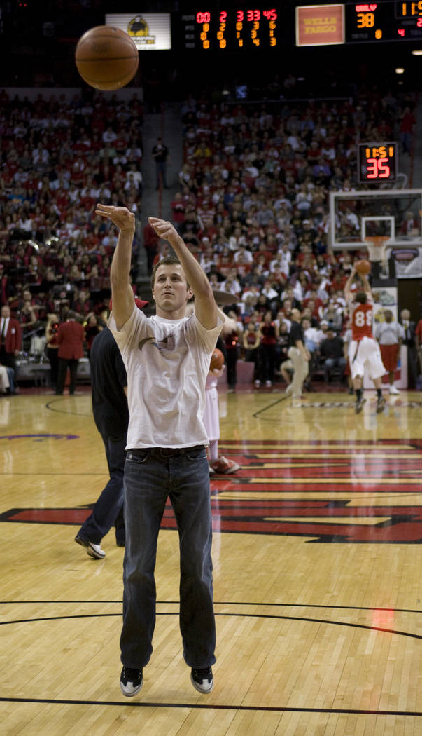 NASCAR driver Kasey Kahne launches the ball during a timeout shooting competition during the second half of the UNLV-San Diego State basketball game at the Thomas & Mack Center Tuesday, Feb. 3, 20 ...