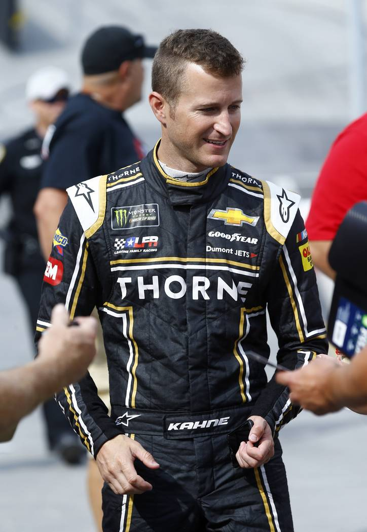 Kasey Kahne prepares to sign autographs before practice for a NASCAR Cup Series auto race, Friday, Aug. 17, 2018, in Bristol, Tenn. Kahne announced Thursday that he will retire from full-time raci ...