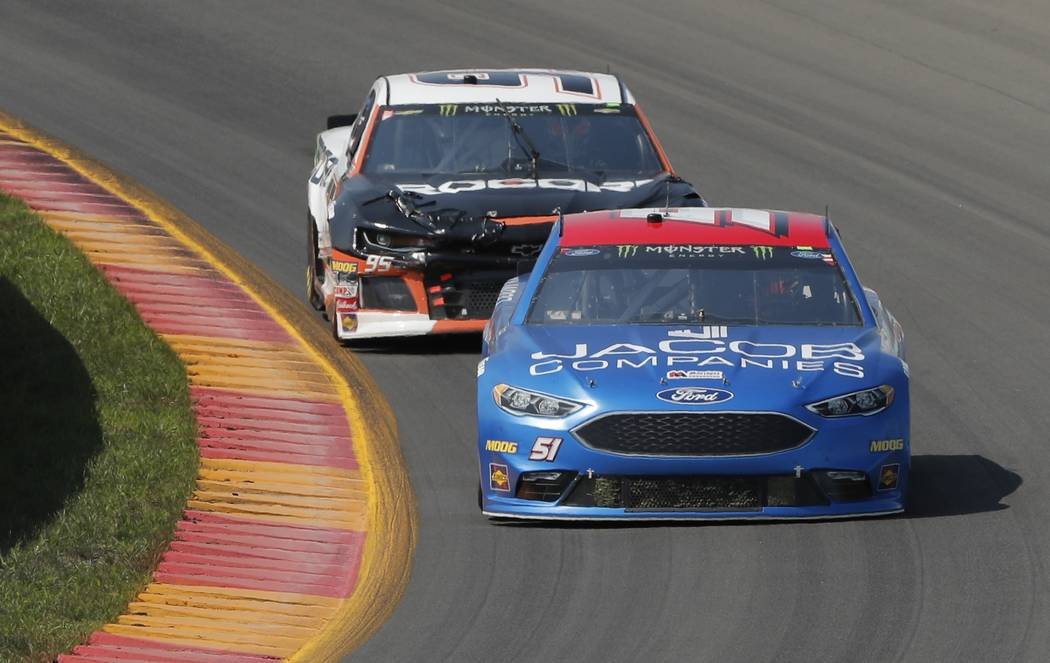Josh Bilicki (51) and Kasey Kahne (95) during a NASCAR Cup series auto race, Sunday, Aug. 5, 2018, in Watkins Glen, N.Y. (AP Photo/Julie Jacobson)