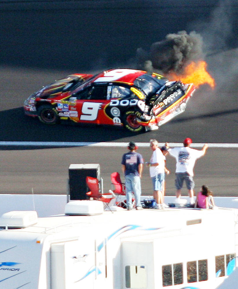 The car driven by Kasey Kahne bursts into flames after spinning into the wall on lap 251 during the NASCAR Nextel Cup UAW-Daimler Chrysler 400 at Las Vegas Motor Speedway Sunday, March 11, 2007. K ...