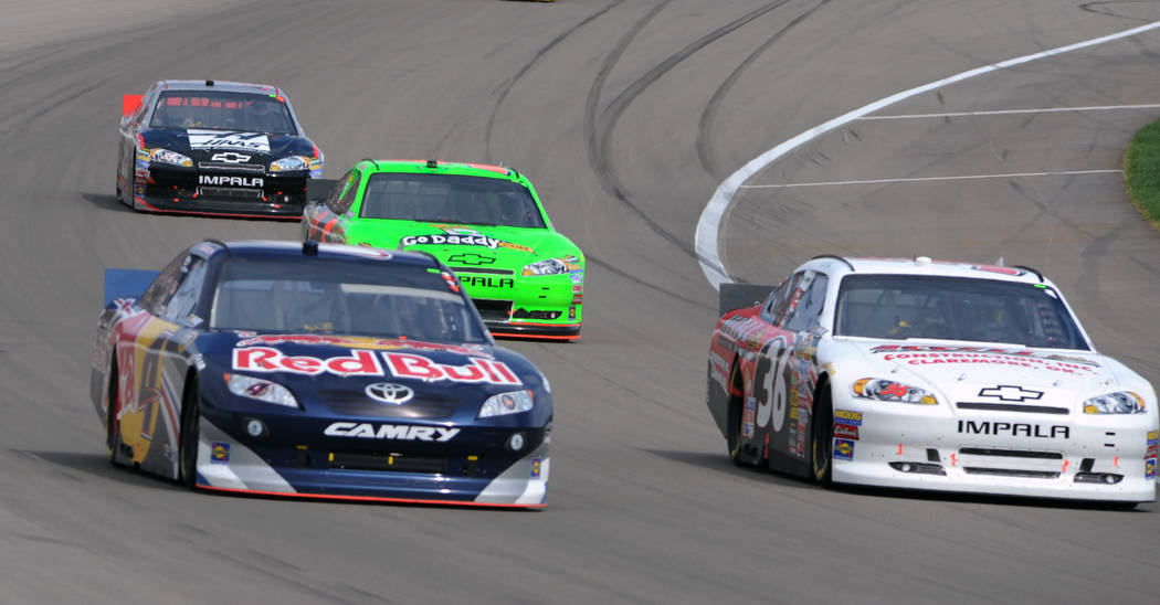 Kasey Kahne (4) passes Dave Blaney (36) coming out of turn 4 in the Kobalt 400 at the Las Vegas Motor Speedway, Sunday, Mar. 6, 2011. Following are Mark Martin in the Go Daddy car and Ryan Newman ...