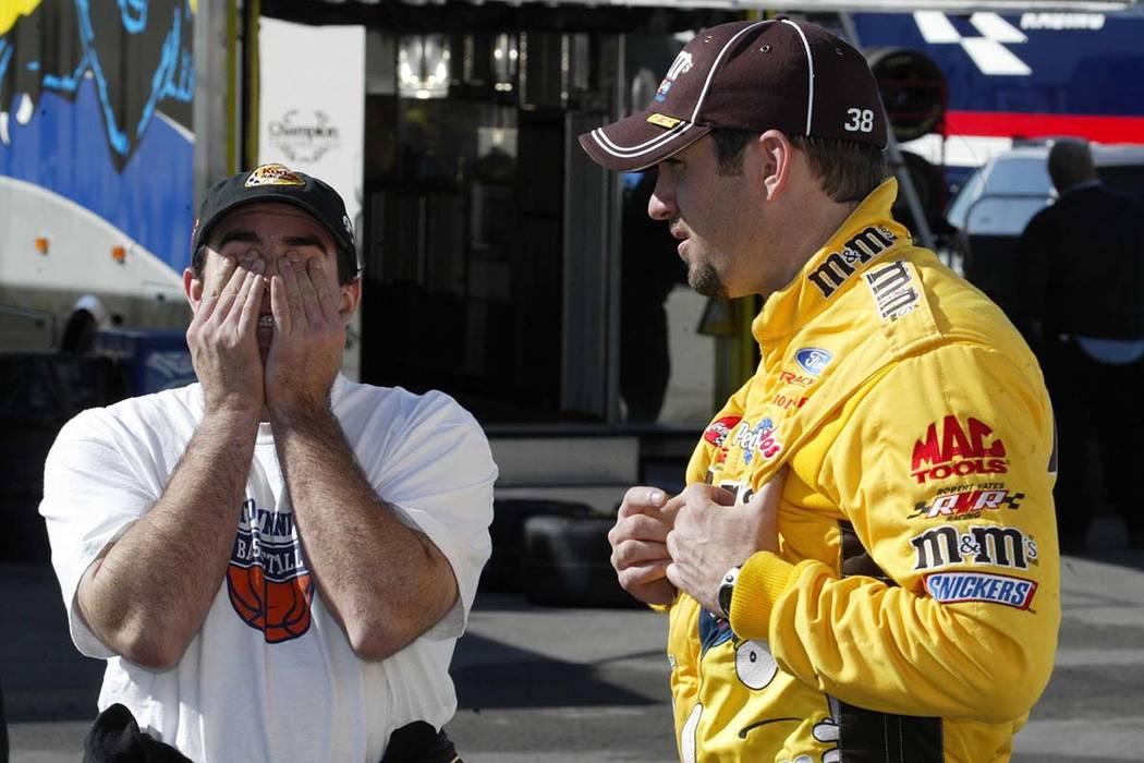 Brendan Gaughn reacts to Elliott Sadler as they talk during a break in Nascar Cup testing at the Las Vegas Motor Speedway on Thursday, Jan. 29, 2004. John Gurzinski/Las Vegas Review-Journal