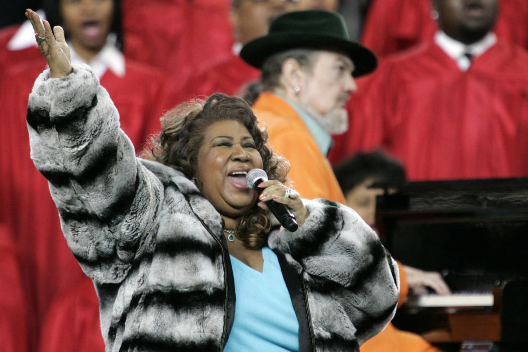 Aretha Franklin and Dr. John, background on piano, perform the national anthem before the Super Bowl XL football game in Detroit on Feb. 5, 2006. Franklin died Thursday, Aug. 16, 2018 at her home ...